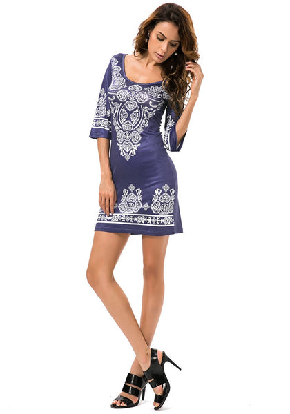 Full body shot of model in navy paisley print dress
