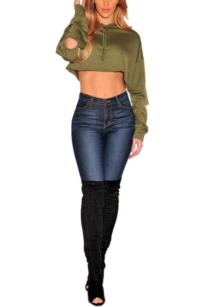 Full body shot of model in olive green ripped hoodie crop top