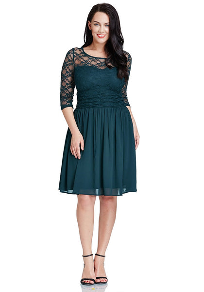 Full body shot of model in peacock lace crop-sleeves skater dress