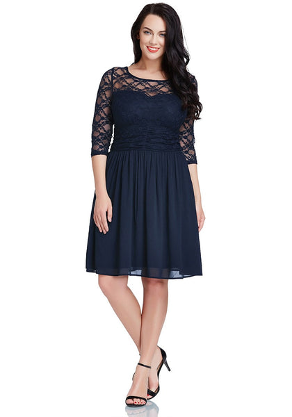 Full body shot of model in plus size navy lace crop-sleeves skater dress