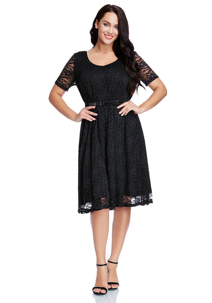 Full body shot of model wearing plus size black lace midi dress