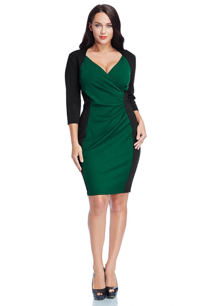 Full body shot of model wearing plus size green raglan sleeve dress