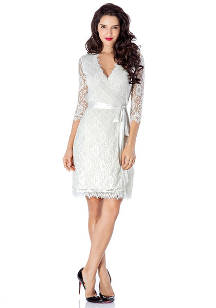 Full body shot of model wearing white lace overlay plunge wrap-style dress