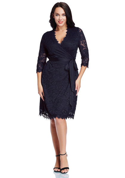 Full body shot of woman in plus size navy lace crop sleeves wrap dress
