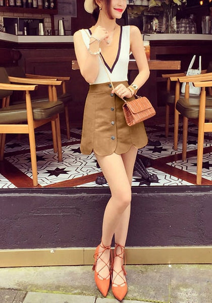 Full front of girl in brown suede scallop hem miniskirt