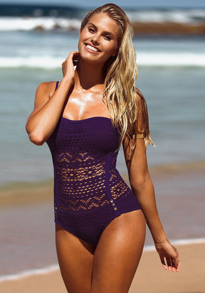 Full front shot of blonde lady posing inpurple lace halter swimsuit