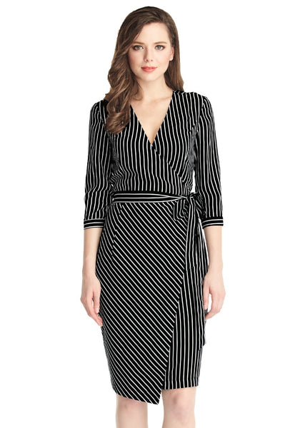 Full front shot of blonde woman in striped plunge asymmetrical belted wrap-style dress