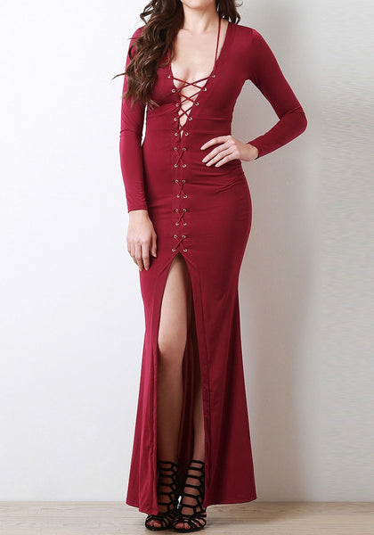 Full front shot of model in a burgundy lace-up long dress
