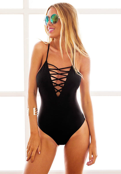Full front shot of model in black lace-up swimsuit