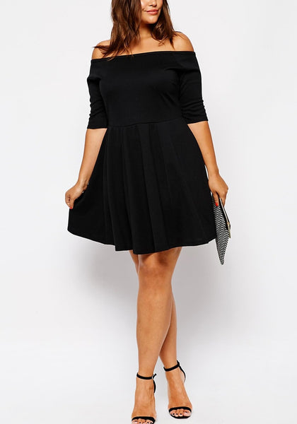 Full front shot of model in black off-shoulder skater dress