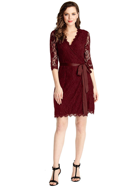 Full front shot of model in burgundy lace overlay plunge wrap-style dress