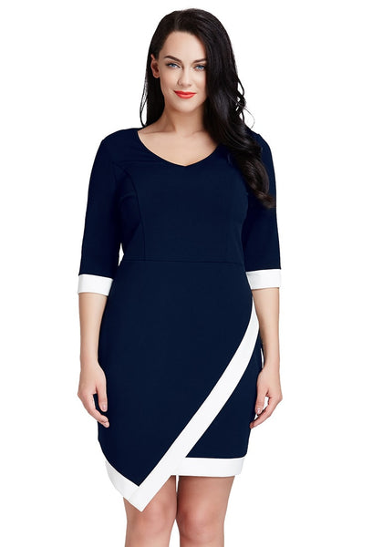 Full front shot of model in plus size navy asymmetric wrap bodycon dress