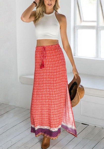 Full front shot of model in red printed maxi skirt