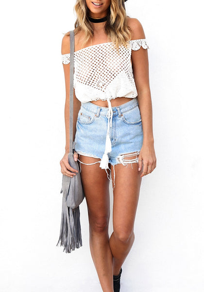 Full front shot of woman in white crochet cutout off-shoulder crop top