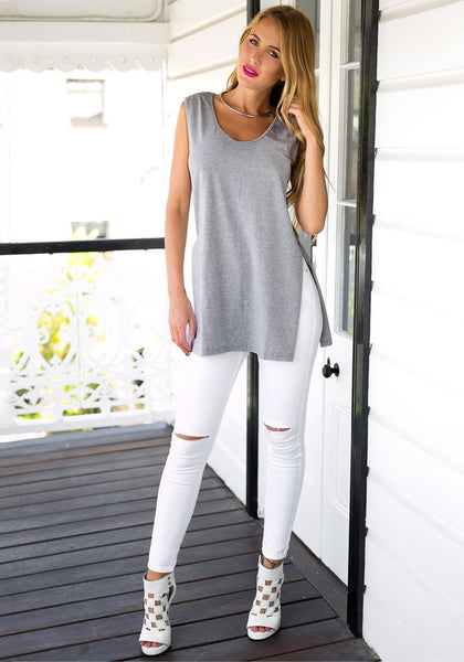Full front view of girl in grey side-slit sleeveless tunic