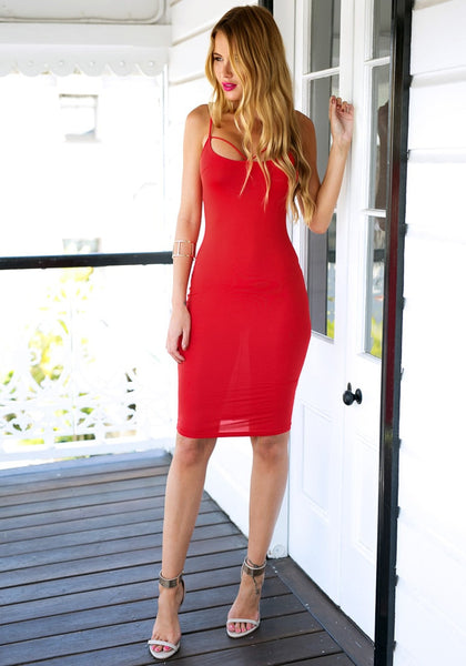 Full front view of girl in red lace-up back bodycon dress