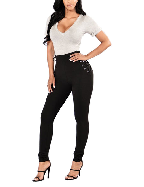 Full front view of model in black lace-up sides grommet leggings