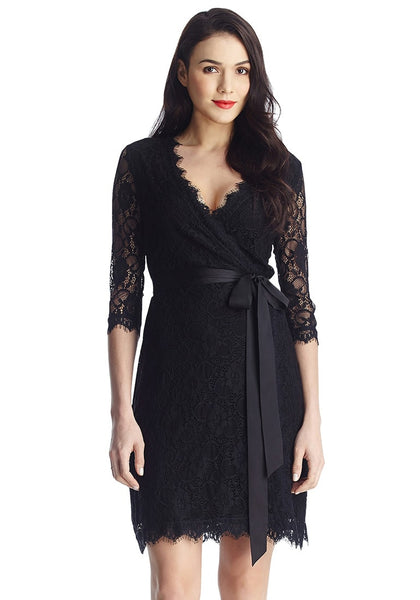Full front view of model in black lace overlay plunge wrap-style dress