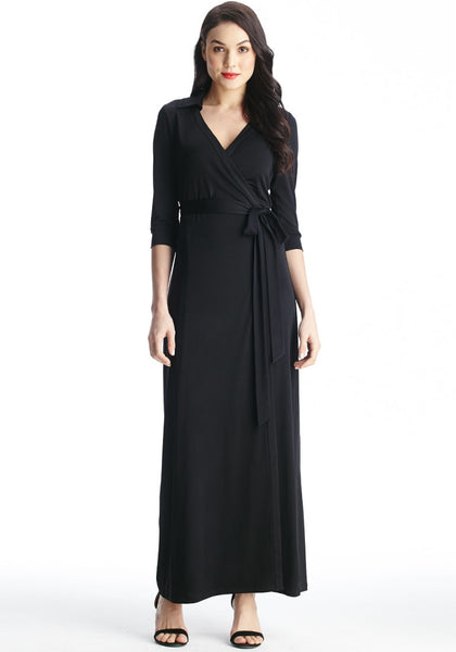 Full front view of model in black plunge wrap belted maxi dress