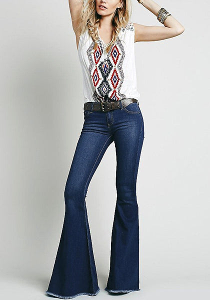 Full front view of model in blue bell-bottom jeans