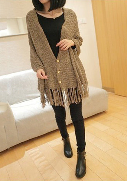 Full front view of model in brown tassel knit shawl