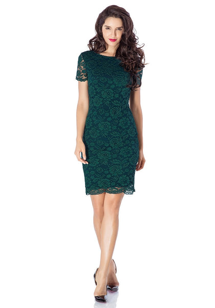 Full front view of model in green lace overlay shift dress