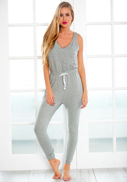 Full front view of model in grey drawstring jumpsuit