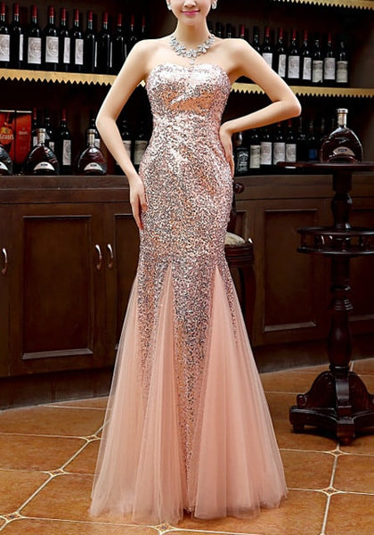 Full front view of model in peach sequin mermaid evening gown