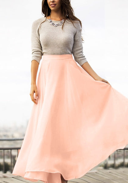 Full front view of model in pink chiffon maxi skirt