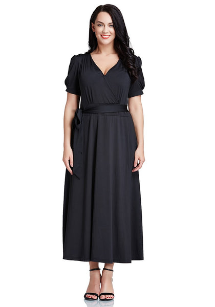 Full front view of model in plus size black surplice belted long dress