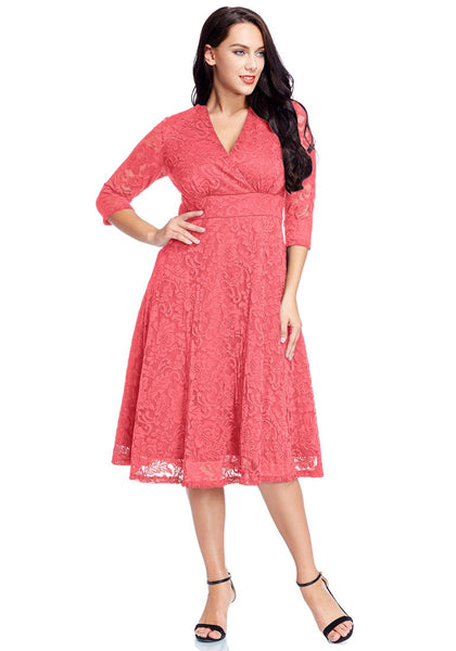 Full front view of model in plus size coral surplice midi dress