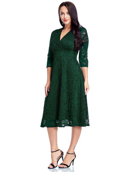 Full front view of model in plus size green lace surplice midi dress