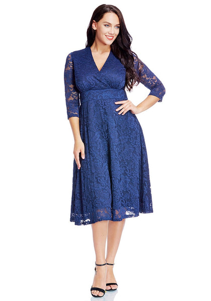 Full front view of model in plus size royal blue lace surplice midi dress