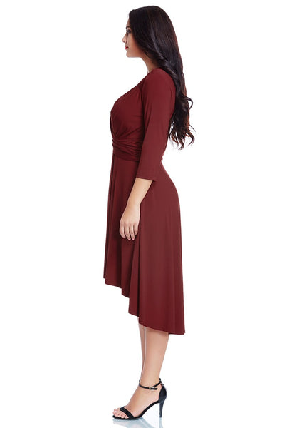 Full left side view of model in burgundy ruched high-low dress
