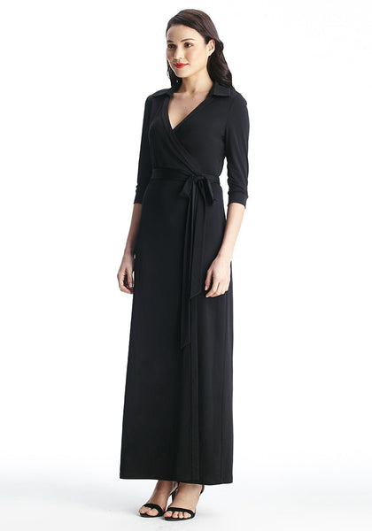 Full left view of model in black plunge wrap belted maxi dress