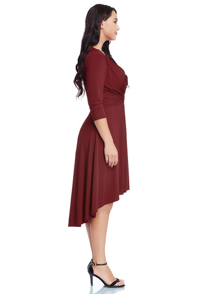 Full right side view of model in burgundy ruched high-low dress