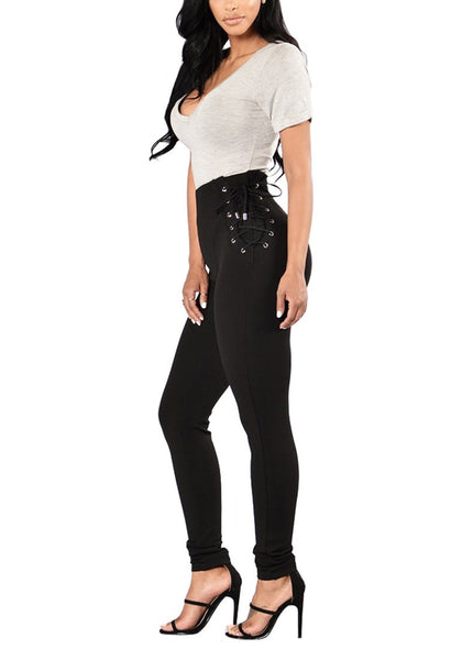 Full side view of model in black lace-up sides grommet leggings