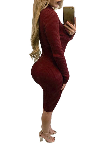 Full side view of model in maroon mock neck belted ribbed midi dress