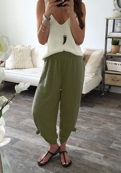 Full view of girl in army green elastic waist lounge pants