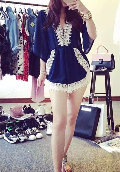 Full view of girl in navy crochet romper