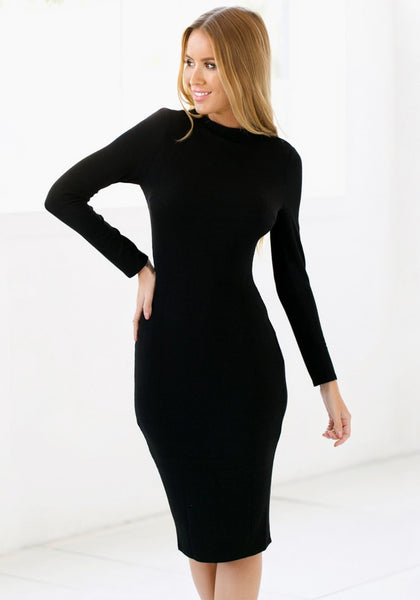 Full view of girl with black mock neck midi dress