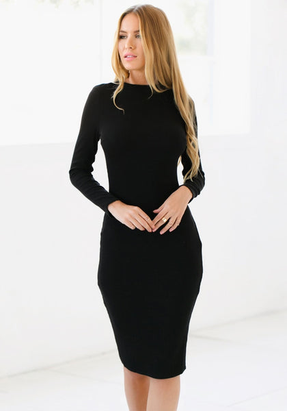 Full view of model in black mock neck midi dress