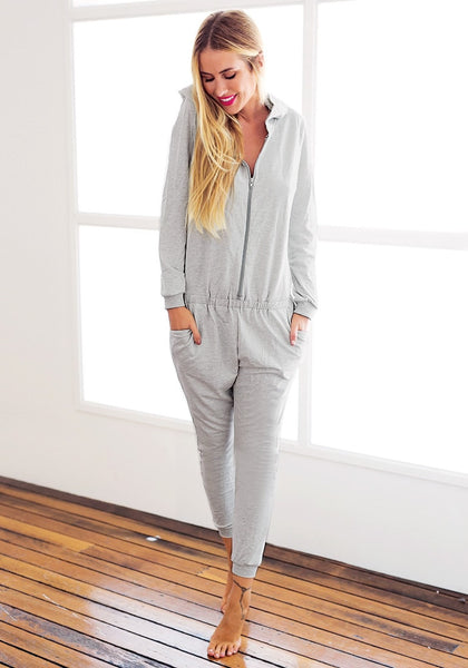 Full view of model in grey hooded pajama jumpsuit