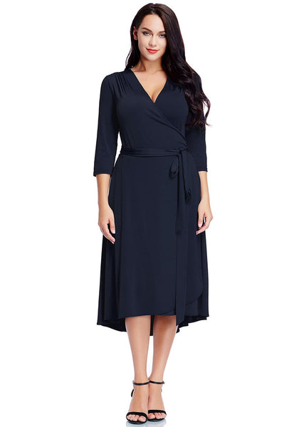 Full view of model wearing plus size navy high-low wrap skater dress