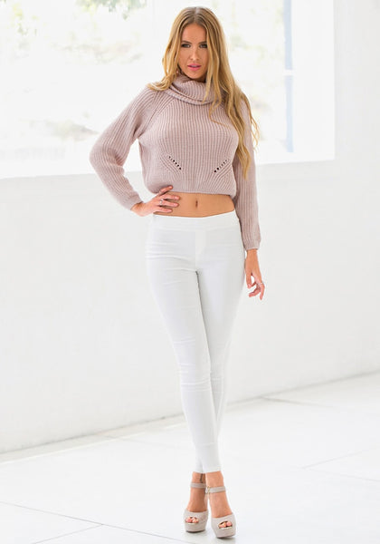 Full view of model wearing white skinny high-waisted pants