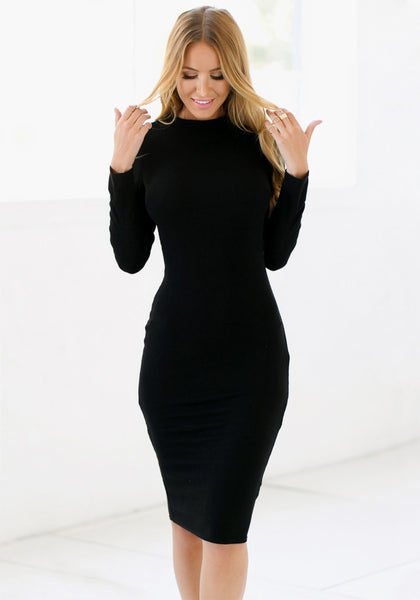 Full view of model with black mock neck midi dress