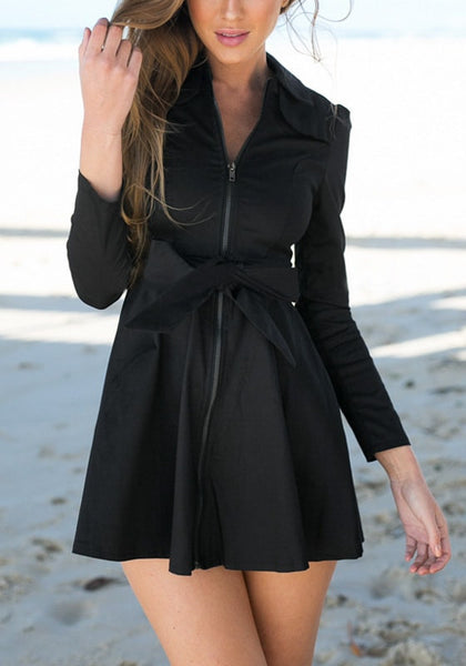 Full view of woman in black zip-up skater dress