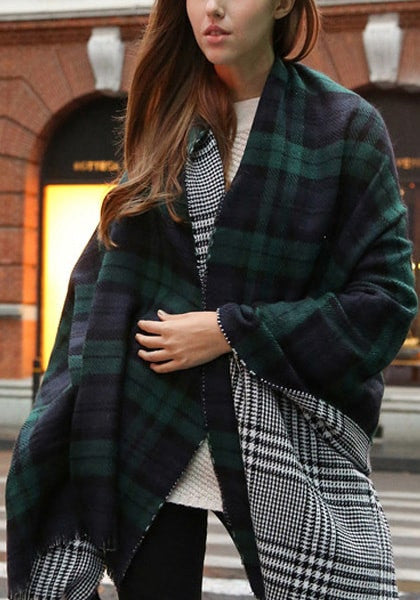 Girl in a green plaid reversible shawl