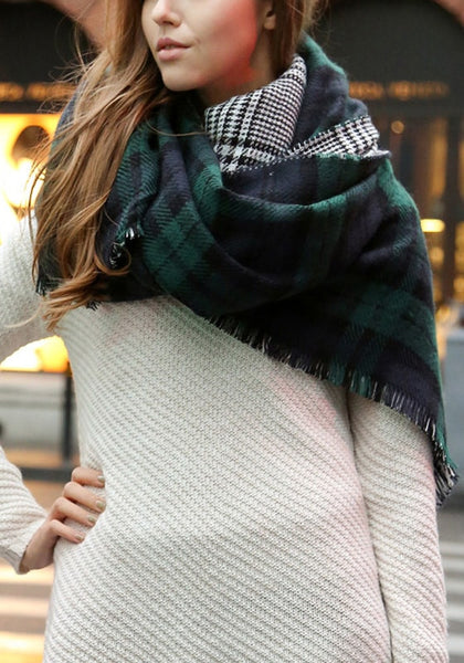 Girl in a white sweater with green plaid reversible shawl in the neck