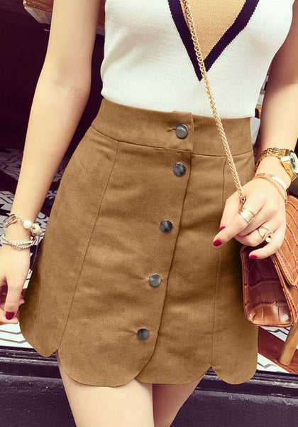 Girl in brown suede scallop hem miniskirt and plunge top